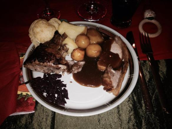 Traditional Danish Christmas dinner! White potatoes, caramelized potatoes, pork roast, duck, red cabbage and gravy