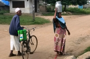 Man and Women after delivering milk to the collection centre in Pongwe Village